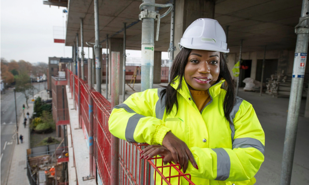 Woman in hard hat on construction site
